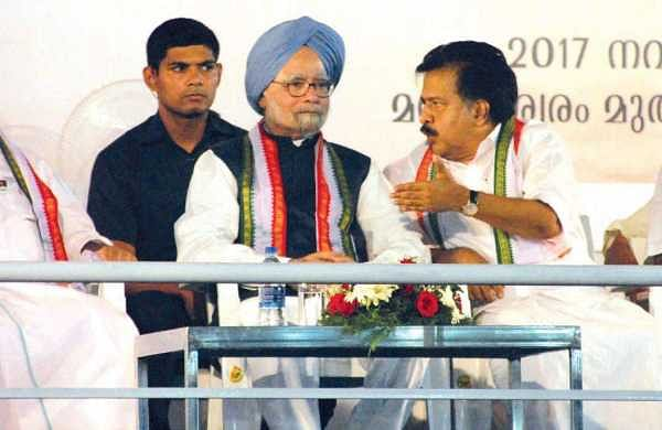 Opposition leader Ramesh Chennithala having a word with former Prime Minister Manmohan Singh at the public meeting held as part of 'Padayorukkam', in Kochi on Friday. KPCC president M M Hassan and P K Kunhalikutty MP are also seen | k shijith