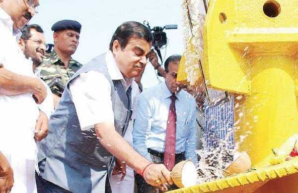 Nitin Gadkari breaks a coconut to mark start of construction of International Ship Repairing Facility at Willingdon Island on Friday | K Shijith