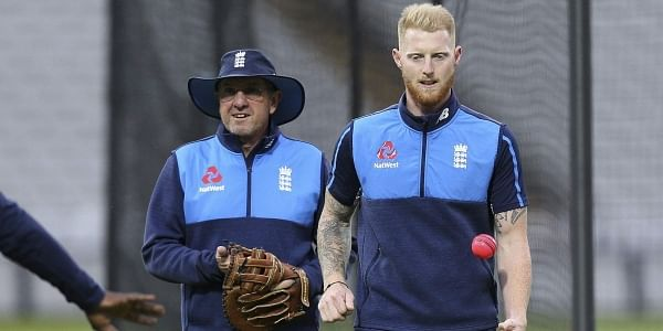 England's coach Trevor Bayliss and Ben Stokes, right, plays with a pink ball during a training session ahead of the day-night Test. | AP