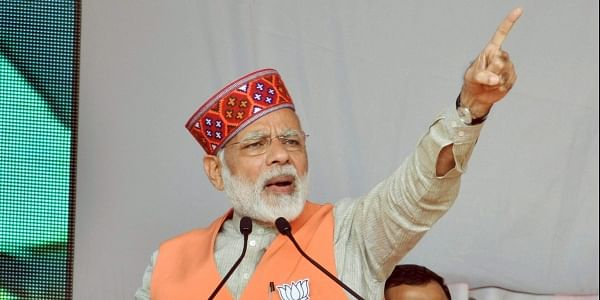 Prime Minister Narendra Modi addresses an election campaign rally in support of BJP candidates in Kangra district on Thursday. | PTI