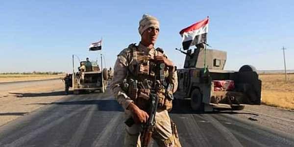 Iraqi security forces gather outside the Kurdish-held city of Altun Kupri on the outskirts of Irbil, Iraq.|AP