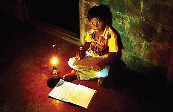 A boy in a tribal hamlet in Kuttampuzha panchayat studies in the light of  a kerosene lamp  | Albin Mathew