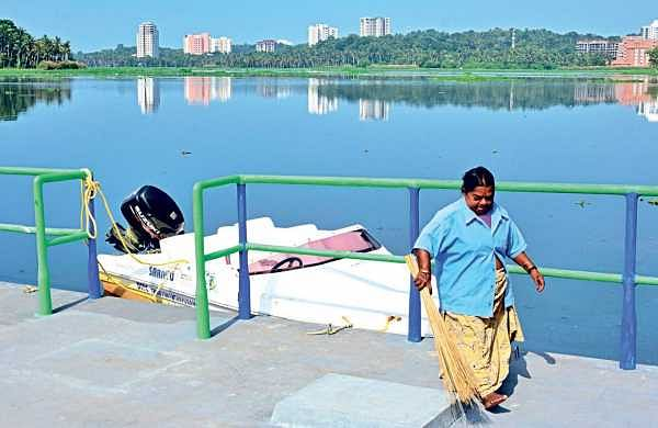 A DTPC worker engaged in cleaning the landing strip at Aakkulam Boat Club  B P Deepu