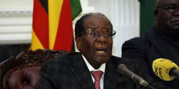 Zimbabwean President Robert Mugabe delivers his speech during a live broadcast at State House in Harare. AP