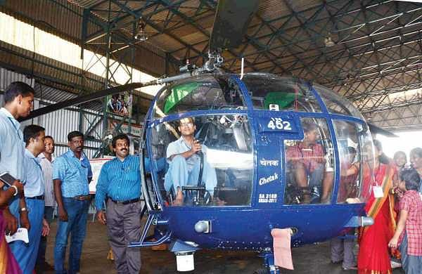 Special children being taken on board a naval helicopter