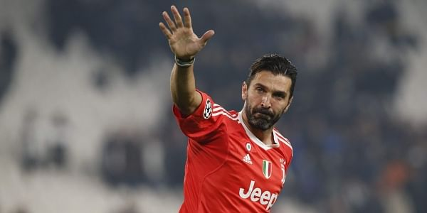 c7862625c2f Juventus goalkeeper Gianluigi Buffon waves to fans at the end of the  Champions League group D soccer match against Barcelona. | AP