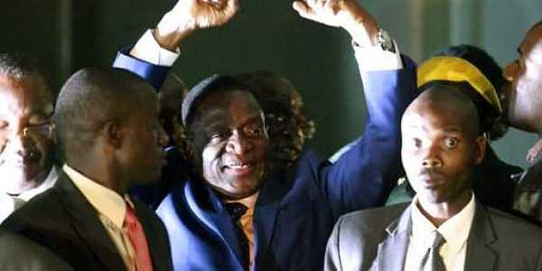 Emmerson Mnangagwa, centre, gestures as he greets the crowd upon arrival at the Zanu PF Headquarters in Harare.| AP
