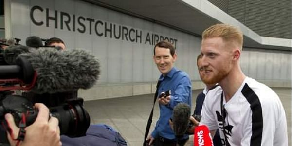 New Zealand-born England cricket star Ben Stokes, right, is surrounded by media as he arrives in Christchurch, New Zealand.| AP