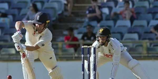 England's Gary Ballance (L) plays a shot watched in front of Western Australia XI wicketkeeper Calum How during a two-day Ashes tour match at the WACA in Perth