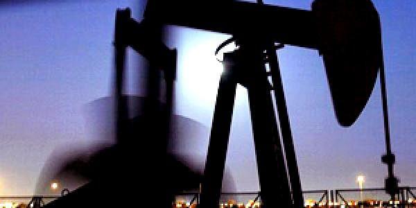 ) An oil pump works in the moonlight, in the oilfields of Sakhir, Bahrain.