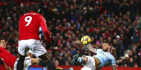 Manchester City's Nicolas Otamendi, right, scores his side's second goal during the English Premier League soccer match between Manchester United and Manchester City at Old Trafford Stadium in Manchester, England. | AP