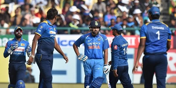 Sri Lanka's Suranga Lakmal and his teammates look on as Indian captain Rohit Sharma wait for 3rd umpire'a decision on his dismissal during the first ODI cricket match at the HPCA Stadium in Dharamshala. | PTI
