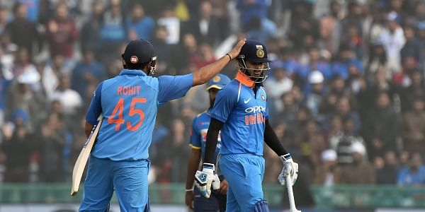 Indian skipper Rohit Sharma pats Shreyas Iyer for his innings as he walks off the field after his dismissal during the second ODI cricket match against Sri Lanka in Mohali. |PTI