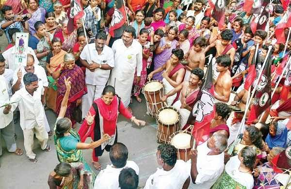 AIADMK supporters dance during campaigning by their candidate E Madhusudhanan at Tondiarpet