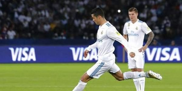 Real Madrid's Cristiano Ronaldo scores the opening goal during the Club World Cup final soccer match between Real Madrid and Gremio at Zayed Sports City stadium in Abu Dhabi. | AP