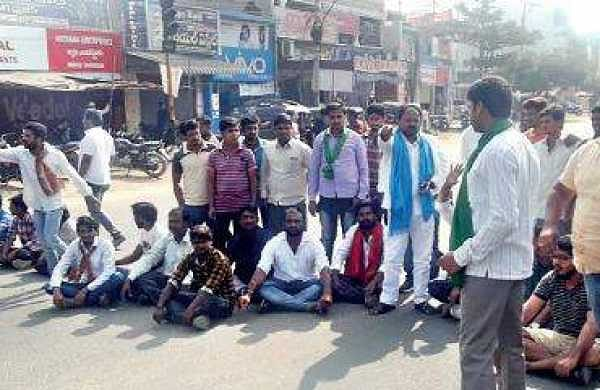 Lambadas stage a protest in front of Kothagudem bus stand as part of the bandh call given against the attacks on them   Express photo