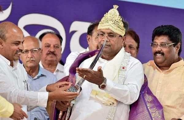 Chief Minister Siddaramaiah was presented a sword by MLA Malikaiah Guttedar at Afzalpur on Saturday