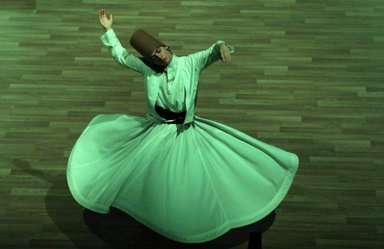 A whirling dervish performs a 'Sema' ritual during a ceremony, one of many marking the 744th anniversary of the death of Mevlana Jalaluddin Rumi, the father of Sufism who lived in the 13th century, at Mevlana Cultural Center in Konya, on December 19, 2017.