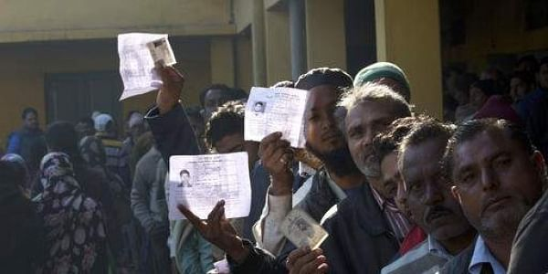 Voters show their identity card as they wait in a queue to cast their votes at Muradnagar, in Indian state of Uttar Pradesh, Saturday, Feb. 11, 2017. Uttar Pradesh and four other Indian states are having state legislature elections in February-March, a key mid-term test for Prime Minister Narendra Modi's Hindu nationalist government which has been ruling India since 2014.(Photo   AP)
