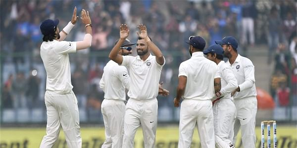 Indian bowler Mohammed Shami along with teammates celebrates the wicket of Sri Lanka's Dimuth Karunaratne during the second day of the third cricket test match at Feroz Shah Kotla. | PTI