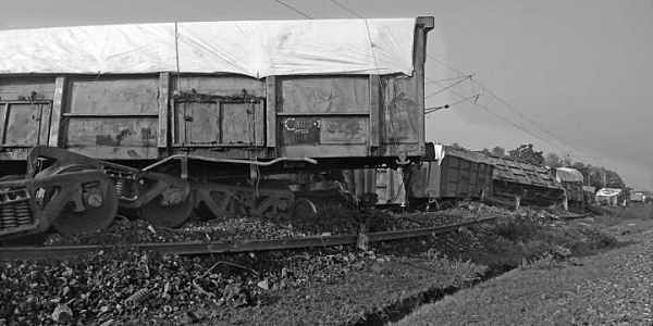 Wagons of a derailed goods train lying on the tracks.