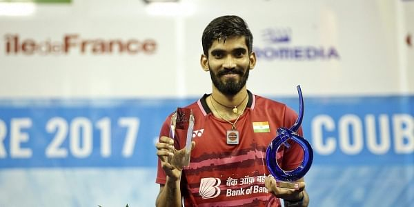 India's Srikanth Kidambi poses for photographers after he won his men's final match of the French Open badminton tournament in Paris.|PTI