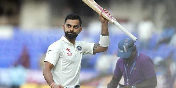 India's captain Virat Kohli raises his bat to acknowledge the applause from the crowd at the end of the play on first day of the test cricket match against Bangladesh in Hyderabad. (Photo | AP)