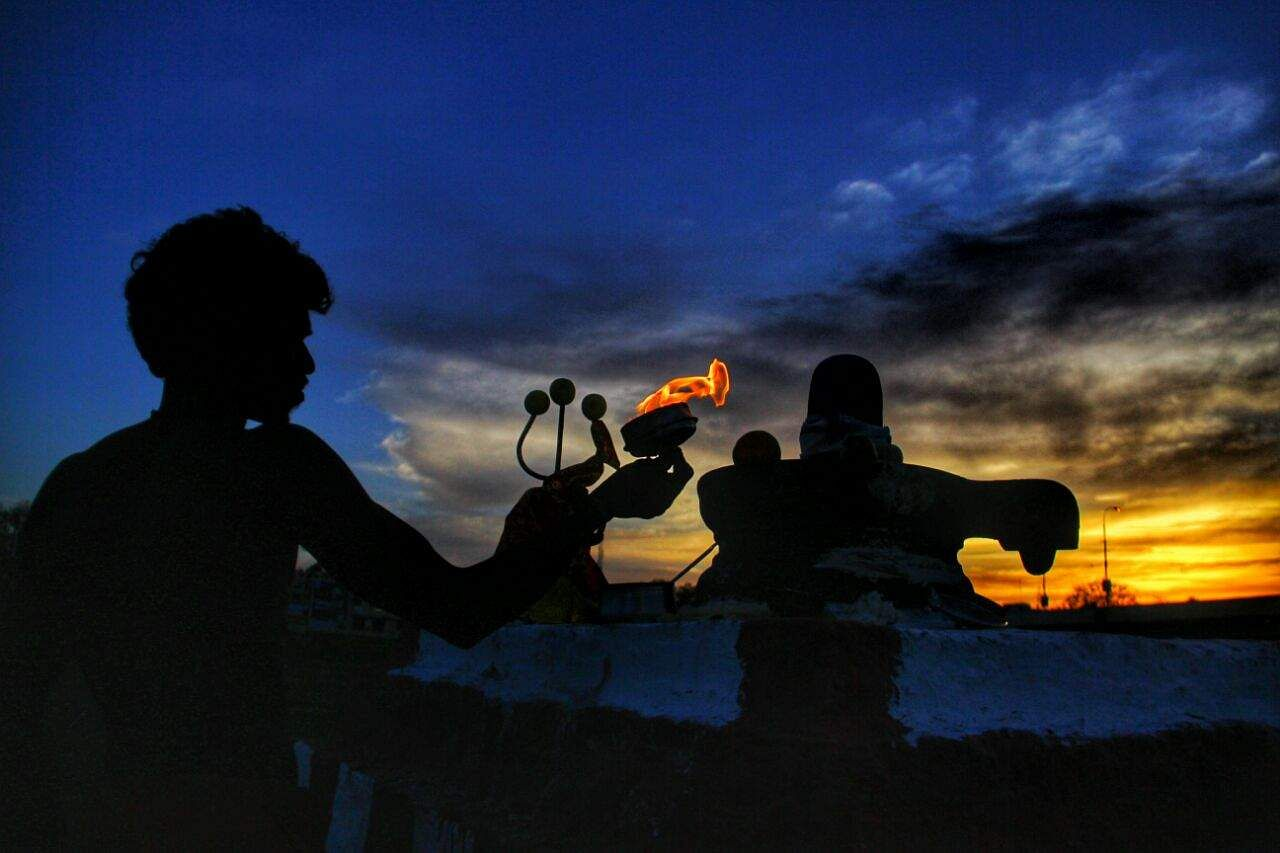 Deepams lit, devotion expressed at a Shiva temple on the banks of the Vaigai river in Madurai on Friday. (K K Sundar | EPS)