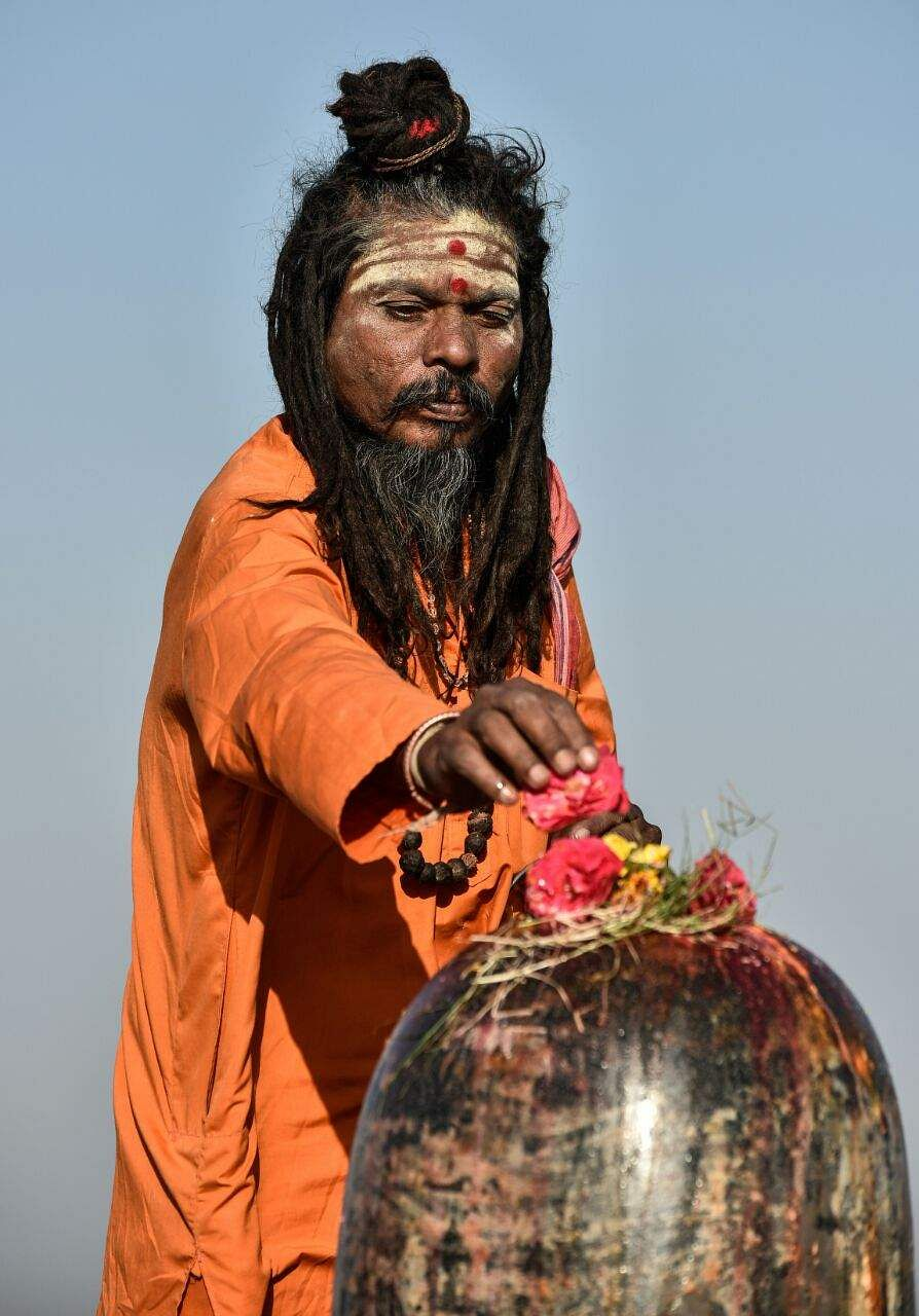 A yogi offers flowes to a Shiva Linga on the occasion of Maha Shivaratri in Hyderabad. (Vinay Madapu | EPS)
