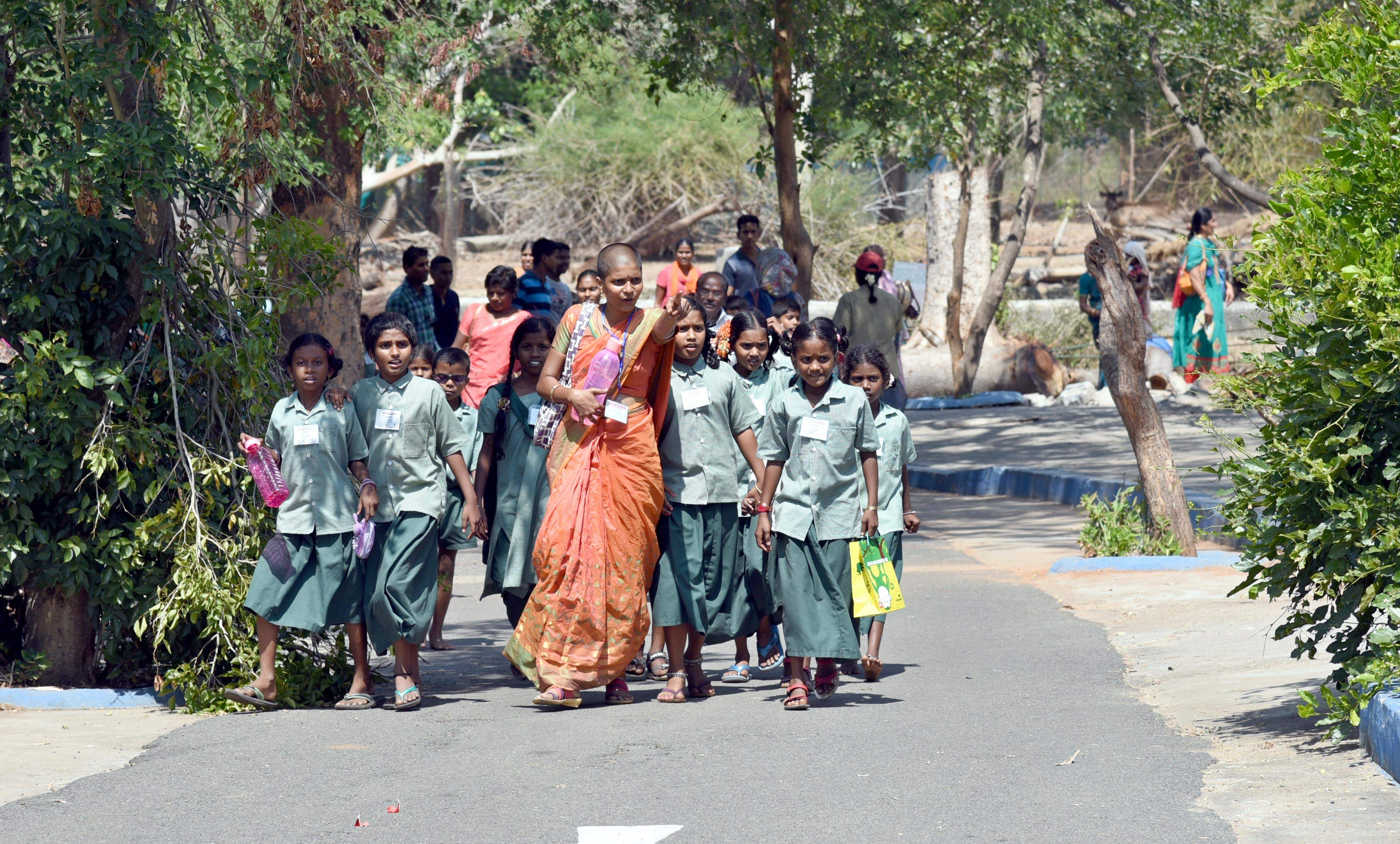 Vandalur Zoo, a popular picnic spot for school children, sees kids again as these school girls walk with their teacher for a trip to the zoo. (Martin Louis | EPS)
