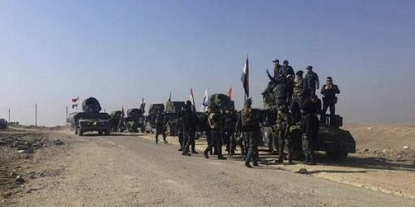 Iraqi Federal police forces advance towards the western side of Mosul on February 23. (File photo | AP)