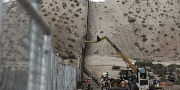 A tall fence in the Mexico-US border area separating the towns of Anapra, Mexico and Sunland Park. (File photo | AP)