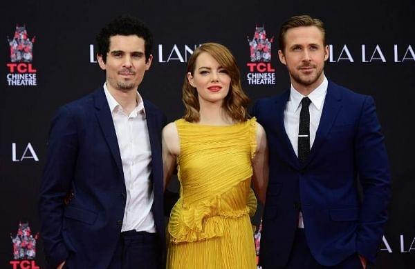 Clean sweep for 'La La Land'? La La Land, Hollywood's love letter to itself, heads into the Oscars with a record-tying 14 nominations.  The whimsical musical romance is favored to win the most coveted best picture prize, beating out fellow frontrunners 'Moonlight' and 'Manchester by the Sea,' as well as six other nominees. The film has already nabbed many of the top honors— Golden Globes, Baftas, guild prizes— leading up to the Academy Awards. Should 32-year-old Damien Chazelle walk away with a statuette, he would be the youngest director ever to win an Oscar.   AFP