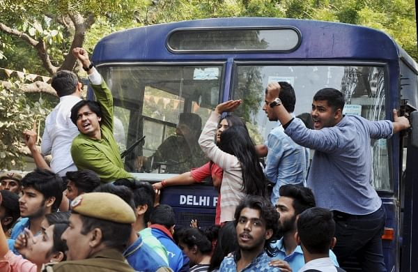 Police detaining ABVP activists after their clash with AISA students at Delhi University in Delhi. (File | PTI)