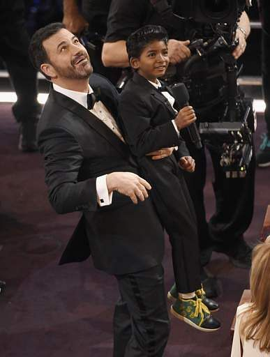 Host Jimmy Kimmel, raises Sunny Pawar in the air at the Oscars on Sunday, Feb. 26 at the Dolby Theatre in Los Angeles. (Photo | AP)
