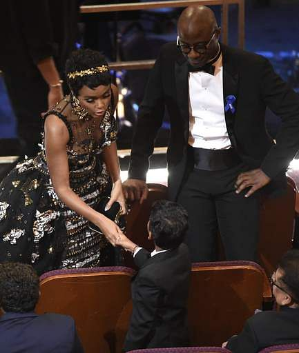 Janelle Monae, shakes hands with 'Lion' actor Sunny Pawar as 'Moonlight' director Barry Jenkins, looks on at the Oscars on Sunday, Feb. 26 at the Dolby Theatre in Los Angeles. (Photo | AP)