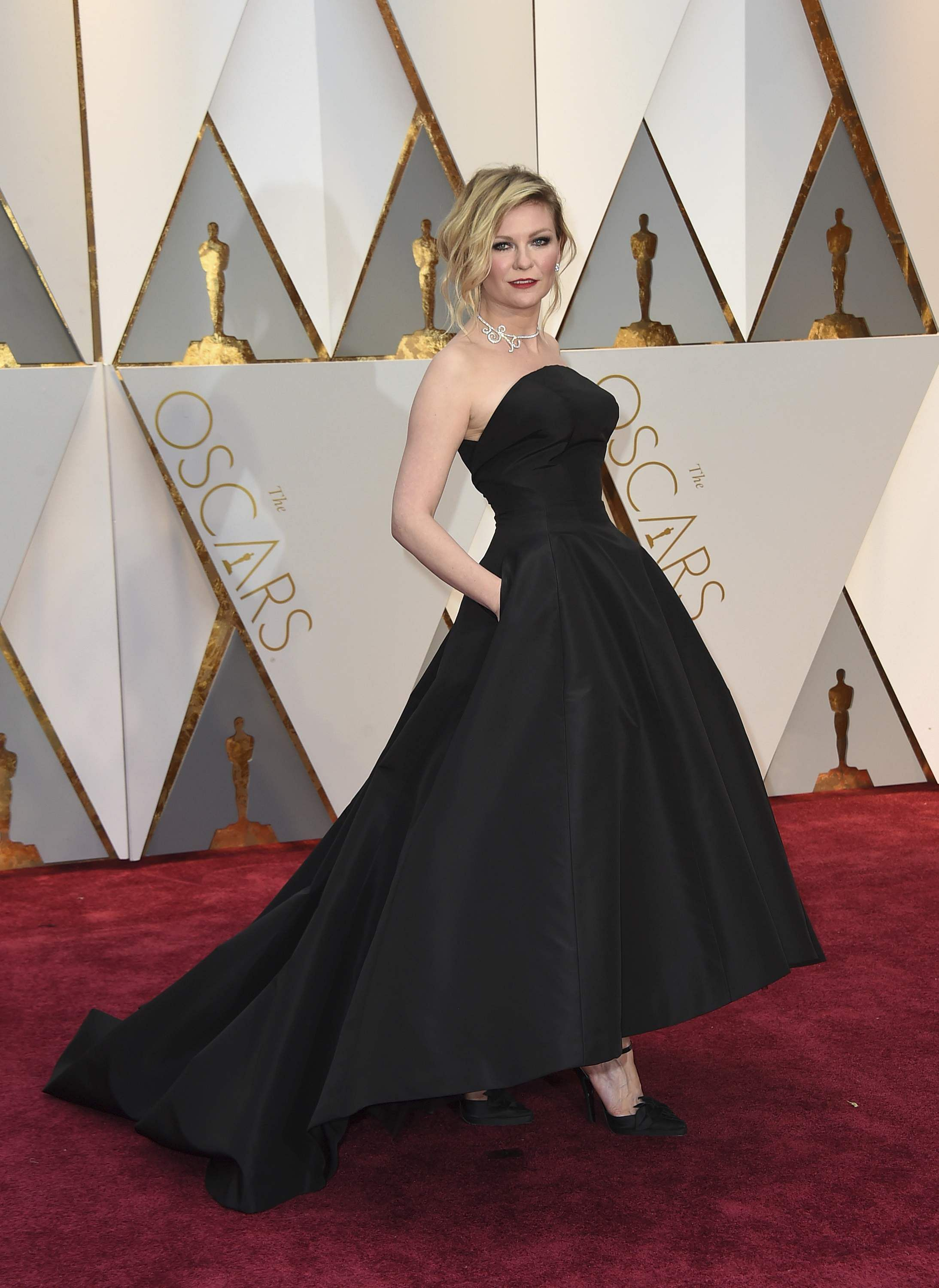Kirsten Dunst looked a bit swallowed-up by her black Dior Haute Couture. She was strapless with a corseted bodice and asymmetric hem that fell at the ankle at the front with a voluminous train behind. | AP