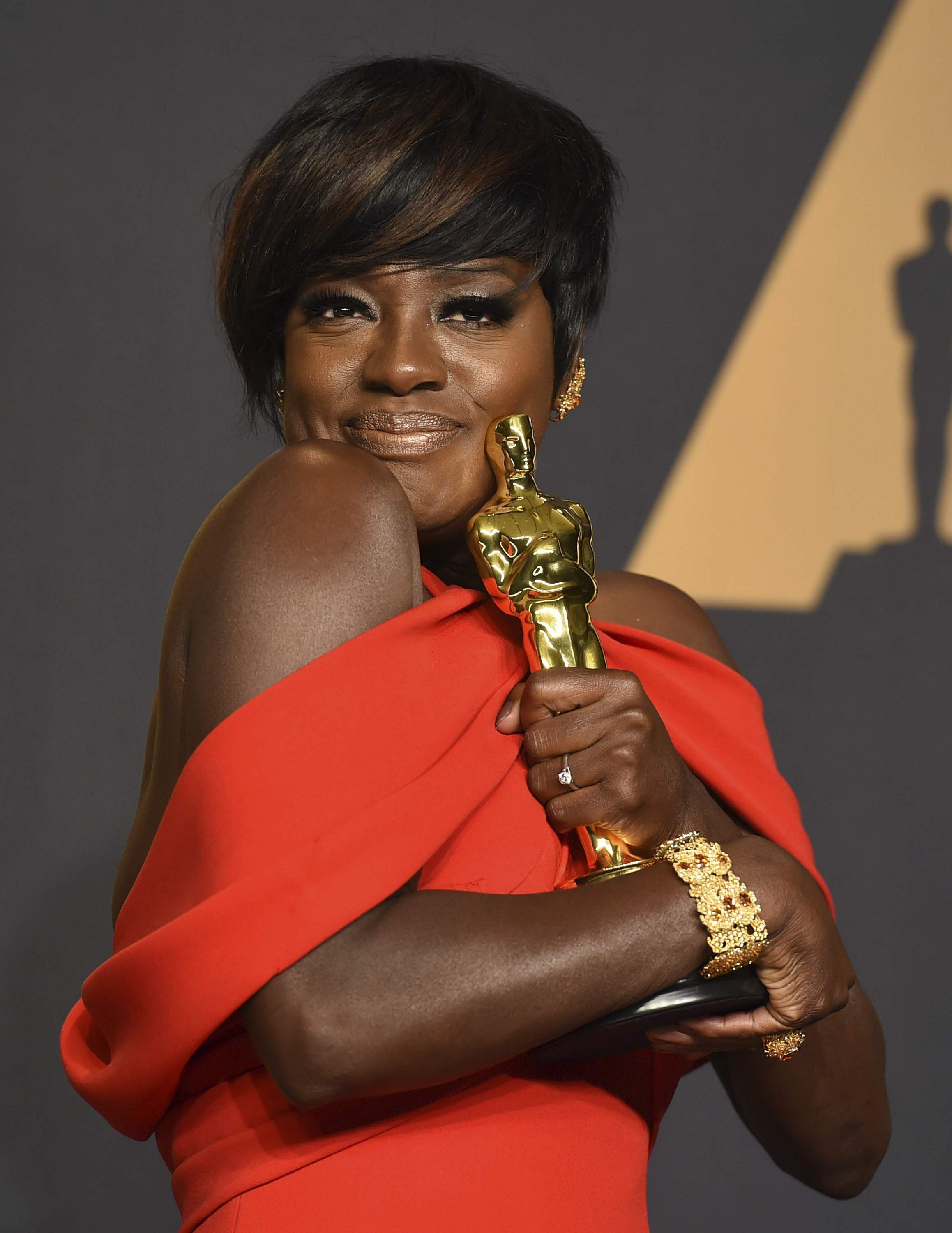 Viola Davis rocked the color as she picked up a best supporting actress Oscar for her role in 'Fences.' She wore silk Armani Prive in vermillion, with the perfect halter neck falling into a pleated capelet effect off the shoulders. Her short hair with bangs swept to one side let the dress shine and she kept jewelry to a minimum. | AP