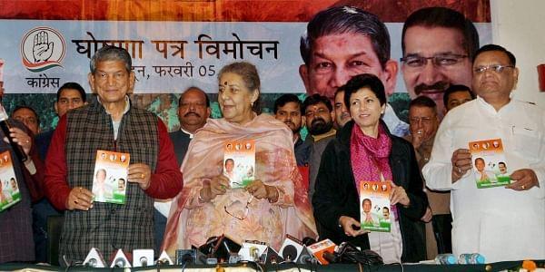 Dehradun Uttarakhand Chief Minister Harish Rawat with Congress leader Ambika Soni Kumari Selja and state unit president Kishore Upadhyay releasing party's poll manifesto for the upcoming Assembly elections in Dehradun on Sunday.(Photo | PTI)