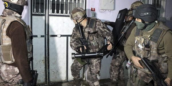 Turkish anti-terrorism police break a door during an operation to arrest people over alleged links to the Islamic State group, in Adiyaman, southeastern Turkey, early Sunday, Feb. 5, 2017.(Photo | AP)