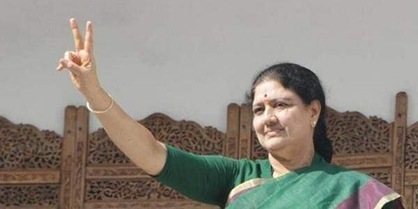 VK Sasikala who is to take over as the next chief minister of Tamil Nadu, displays the hand gesture denoting the AIADMK's two leaves symbol, wearing a green saree, a colour favoured by her predecessor J Jayalalithaa, at the party office in Chennai. ( Ashwin Prasath | EPS)