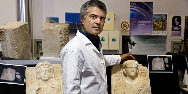 Italian restorer poses between two limestone male, right, and female busts dated between the 2nd and the 3rd century A.D. were damaged during the Islamic State occupation of the Syrian city of Palmyra. (File Photo | AP)