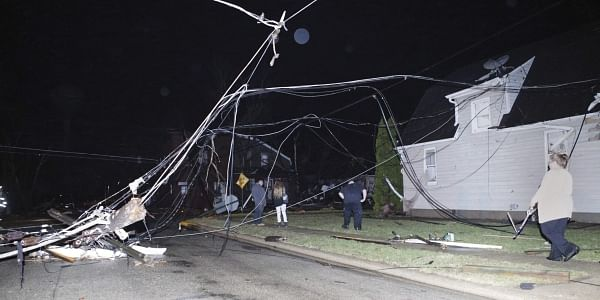 People walk through downed wires after a storm moved through Naplate, Ill., Tuesday, Feb. 28, 2017. (Photo | AP)