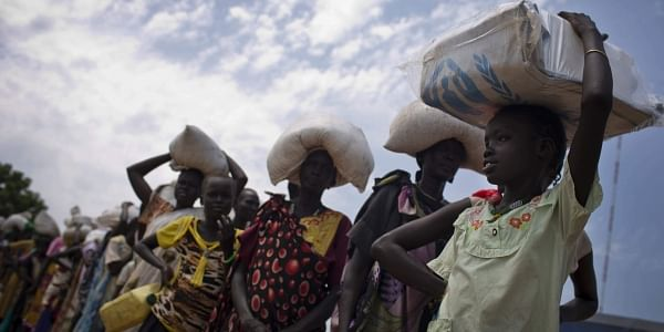 A young girl queues for food aid at a food distribution made by the WFP in South Sudan. (File Photo | AP)