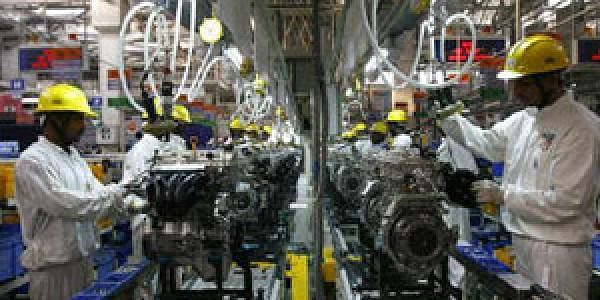 Employees work inside Maruti Suzuki's petrol engine plant on the outskirts of New Delhi. (File photo | Reuters)