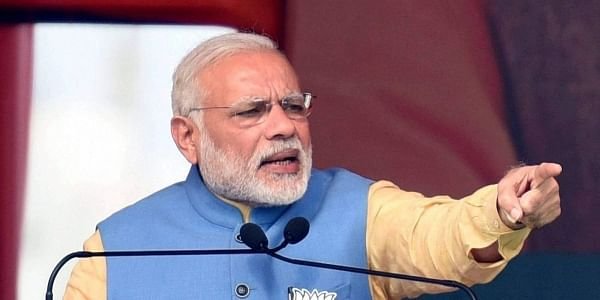 Prime Minister Narendra Modi addresses an election rally in Aligarh on Sunday. The rally drew huge crowd with BJP workers pouring in from all sides.(Photo   PTI)