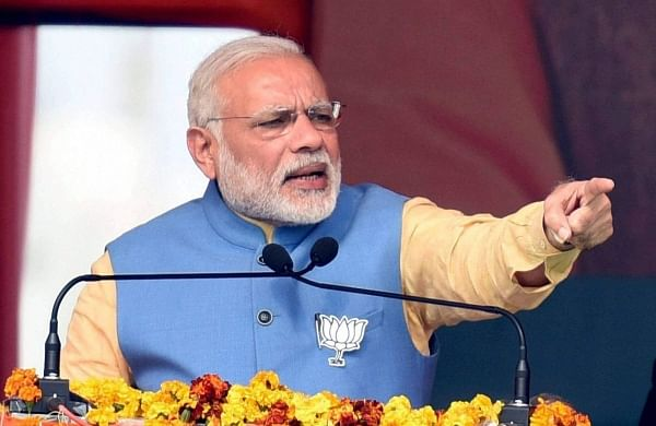 Prime Minister Narendra Modi addresses an election rally in Aligarh on Sunday. The rally drew huge crowd with BJP workers pouring in from all sides.(Photo | PTI)