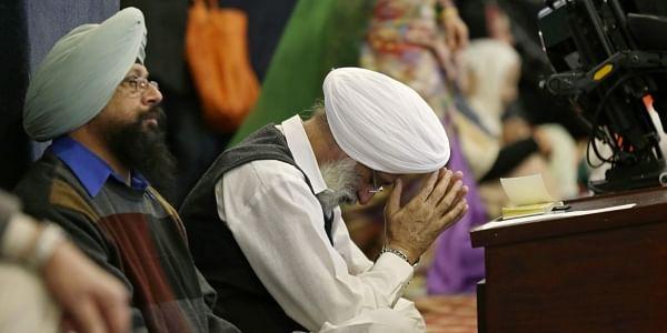 A man bows his head as he attends Sunday services at the Gurudwara Singh Sabha of Washington, a Sikh temple in Renton, Washington (Photo | AP)