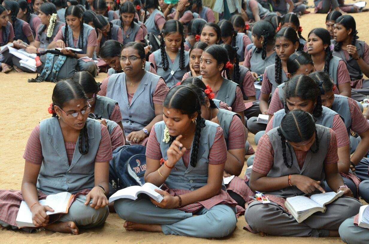 Students in Tiruchy sit on the school grounds engaged in some last minute preparations. (M K Ashok Kumar | EPS)