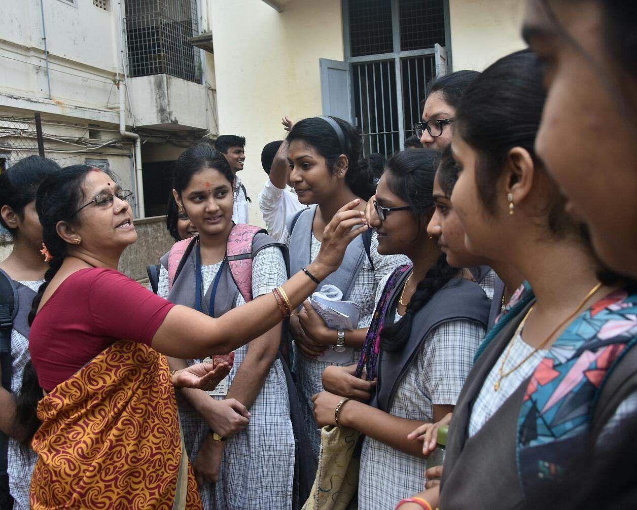 Students take the blessings of their teacher right before the first board exam in Chennai's Mylapore. (Ashwin Prasath | EPS)